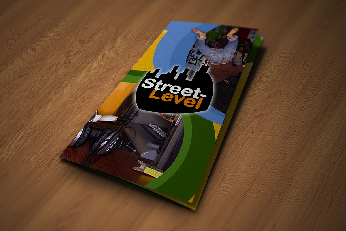 Youthful tri-fold brochure cover mock-up on wood floor